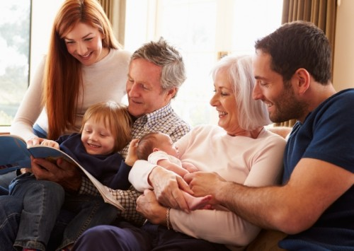 A family reading a legal factsheet on Wills, Probate, Tax and Trusts