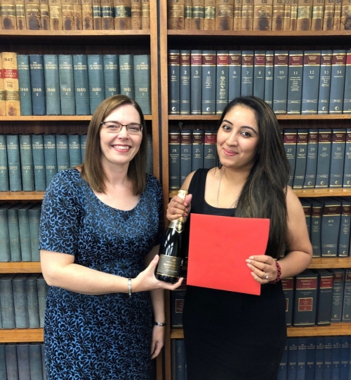 HOD, Lorna Watts congratulating Arti Thakrar on becoming a Solicitor.